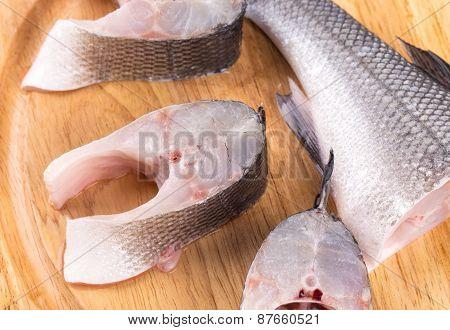 Fillet of fresh raw fish on a cutting board.