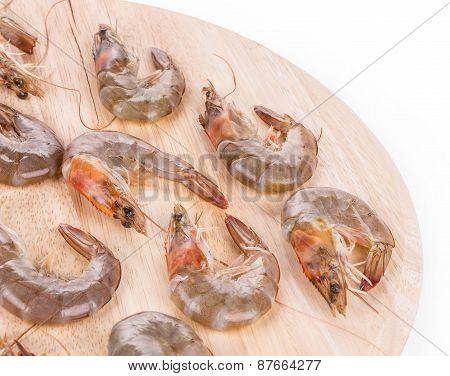 Fresh shrimps on round board.