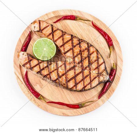 Salmon steak on platter.