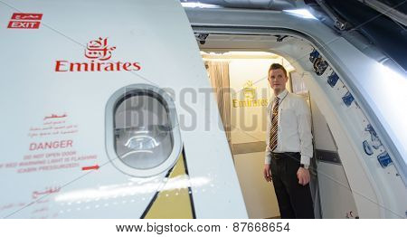 BANGKOK, THAILAND - MARCH 31, 2015: Emirates A380 crew member meet passengers. Emirates is one of two flag carriers of the United Arab Emirates along with Etihad Airways and is based in Dubai.