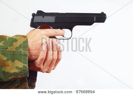 Hands in camouflage uniform with semi-automatic gun on white background