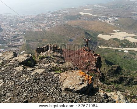 Woman On A Top Of A Mountain
