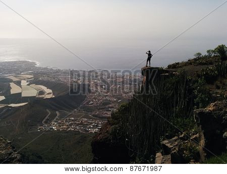 Woman On A Edge Of A Mountain Enjoying Valley View