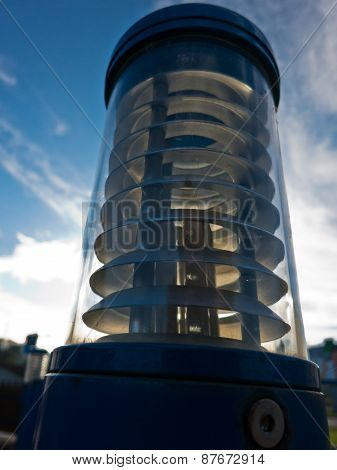 Energy saving outdoor lamp against blue sky