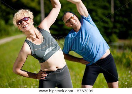 Senior couple doing sport exercising outdoors