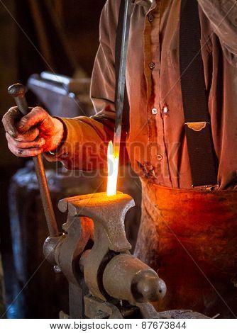 Blacksmith Bending A Hot Metal Rod