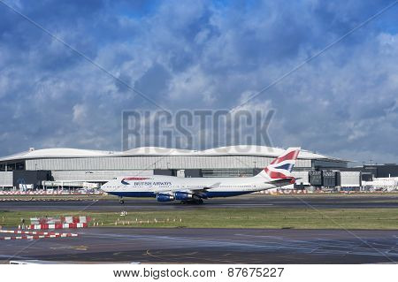 British Airways Plane Takibg Off At Heathrow Airport On Cloudy Day