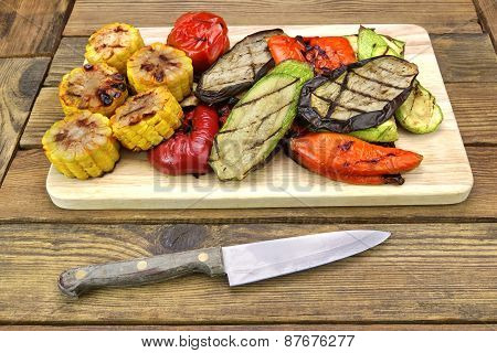 Knife And Grilled Vegetables Assortment On The Wood Table Background