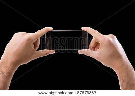 Hand holding Smartphone in horizontal on black background