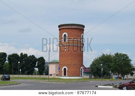 Old water tower of red brick.Belarus. Central Europe
