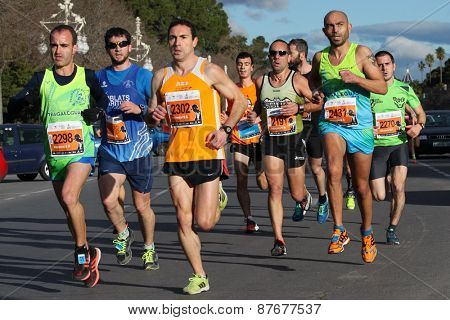 VALENCIA, SPAIN - FEBRUARY 22, 2015: Runners compete in the IV University of Valencia 5K run in the streets of Valencia.