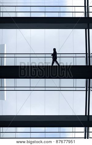 man inside a modern office building