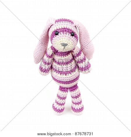 Sad Knitted Rabbit Toy Stands Over White Background