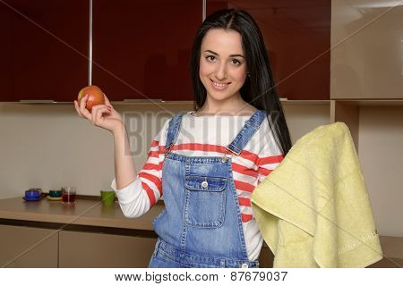 Housewife Brunette In Home Clothes Wipes Apple By Towel