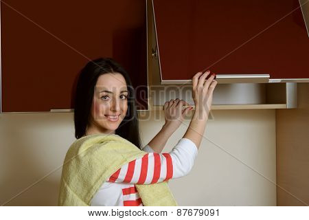 Housewife Brunette In Home Clothes Kitchen Cupboard Opens
