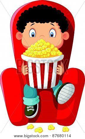 Cartoon boy watching movie in the cinema