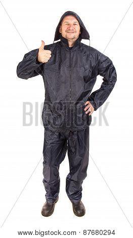 Man in black rain coat.
