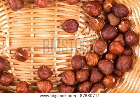Close up of hazel nuts on a wicker basket.