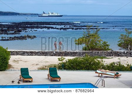 Unidentified tourists enjoying the beach in a hotel, Santa Cruz, Galapagos Islands