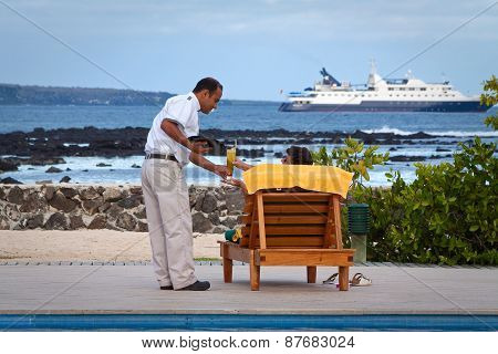 Unidentified tourist in a beach hotel enjoying the ocean view, Santa Cruz, Galapagos Islands