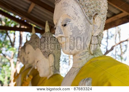 Old Buddha Statue With Yellow Robe