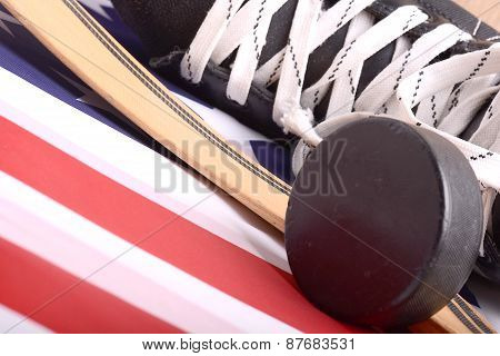 Puck, Skates And Hockey Stick Of The American Flag