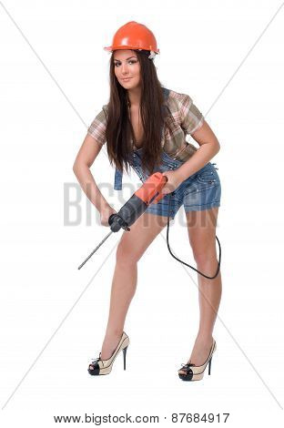 Young woman in jeans witch electric hammer drill.Isolated.