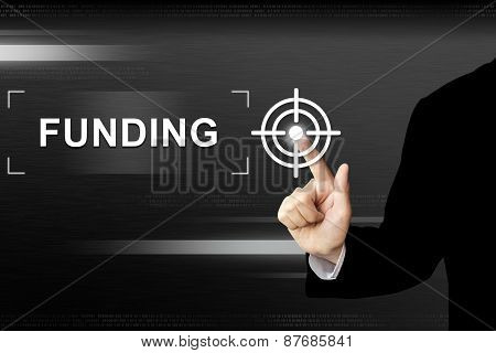 Business Hand Pushing Funding Button On Touch Screen