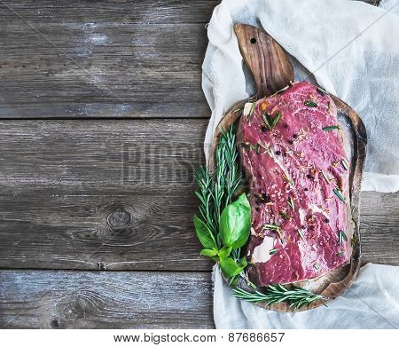 A Piece Of Raw Fresh Beef (ribeye Steak) Marinated In Spices And