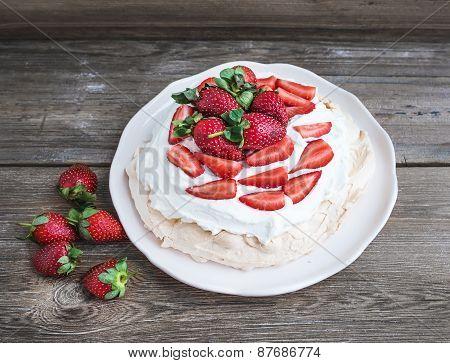 Rustic Pavlova Cake With Fresh Strawberries And Whipped Cream Ov