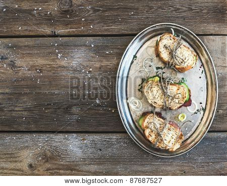 Rustic Sandwich Set. Sandwiches With Smoked Meat, Cucumber, Onion, Herbs And Spices On A Metal Dish