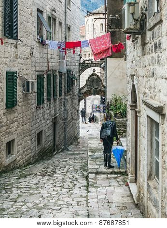 Narrow Paved Street Of The Old Town Of Kotor And The Strange