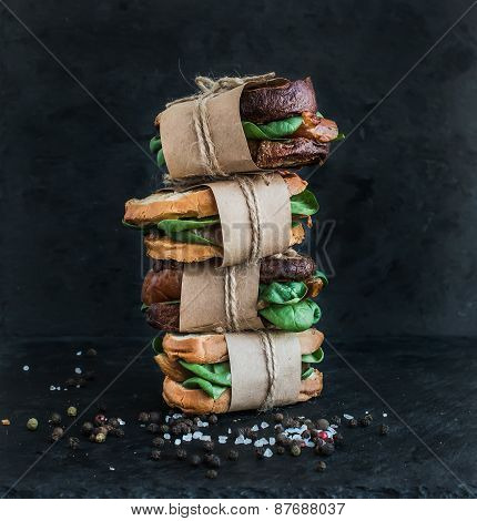Cured Chicken And Spinack Whole Grain Sandwich Tower With Spices On A Black Stone Background
