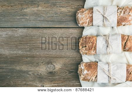 Freshly Baked Rustic  Village Bread (baguette) Set On Rough Wood Background With A Copy Space