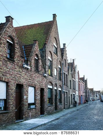 Medieval Style Houses In A Street Of Bruges, West Flanders