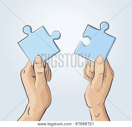 Two hands holding pieces of the puzzle