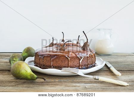 Pear, Ginger And Honey Cake With Creamy Caramel Topping, Fresh Pears And A Jug Of Milk  On A Rustic