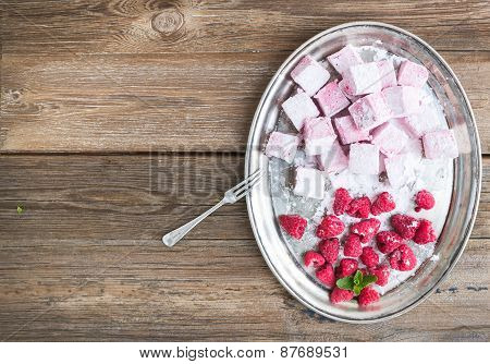Homemade Raspberry Marshmallow With Fresh Raspberries And Sugar Powder On A Silver Dish Over A Rusti
