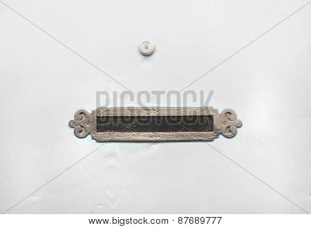 Vintage Mail Slot A And A Spy Hole On A White Door