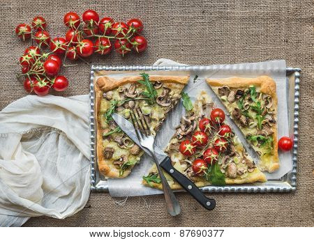 Ristic Mushroom (fungi) Square Pizza With Cherry Tomatoes And Arugula Over A Sackcloth Surface