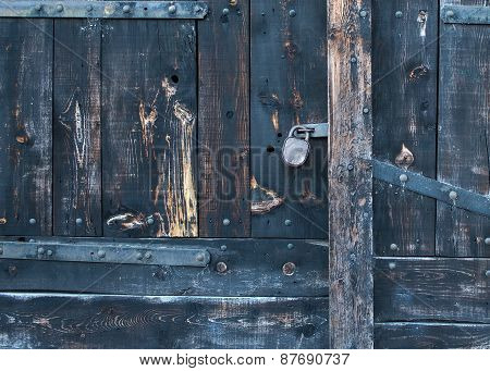 Old Rustic Faded Wood Gate With A Lock