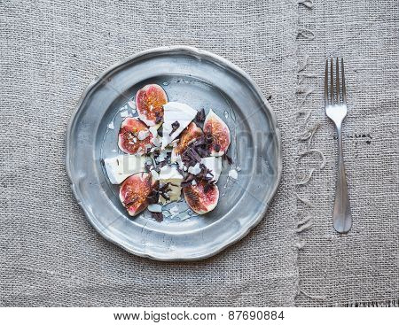 Dessert Consisting Of Fresh Figs And Brie Cheese With Honey, Almond Petals And Chocolate Chips On A