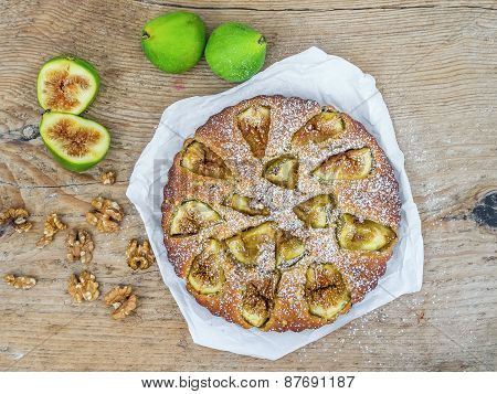 Fig Cake With Fresh Figs And Walnuts On A Rought Wood Surface