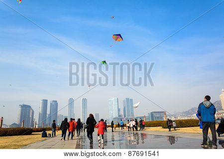 Dalian, China - March 15, 2015 :  People Flying Kites At Xinghai Square, Dalian China