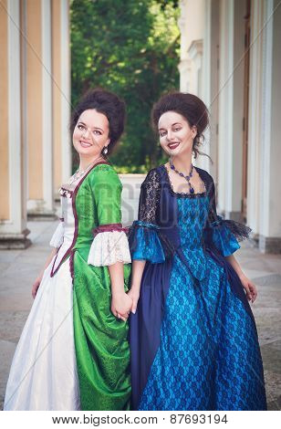Two Young Beautiful Women In Long Medieval Dresses