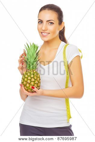 Young girl with pineapple isolated