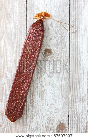 Premium stick of salami. Cut.