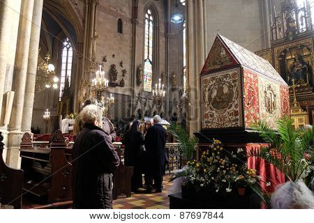 ZAGREB, CROATIA - 05 APRIL: Easter morning, people pray in front of God's tomb in the Zagreb Cathedral on April 05, 2015