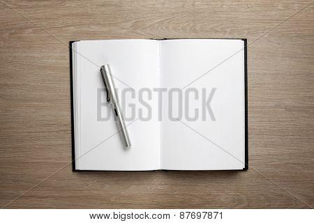 Open book on office desk