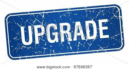 Upgrade Blue Square Grunge Textured Isolated Stamp